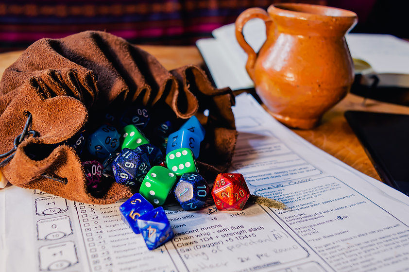 Roleplaying dice of various shapes and c
