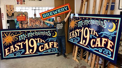 Hand painted signs for McMenamins East 19th Cafe in Eugene, OR USA