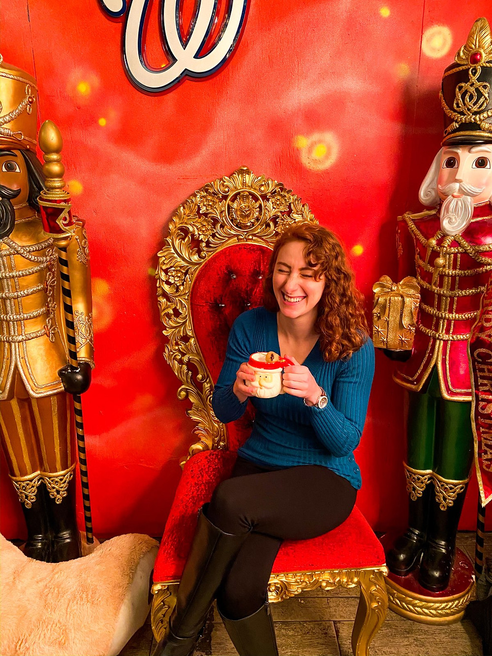 Laughing next to nutcrackers