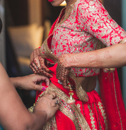 Indian bride being assisted
