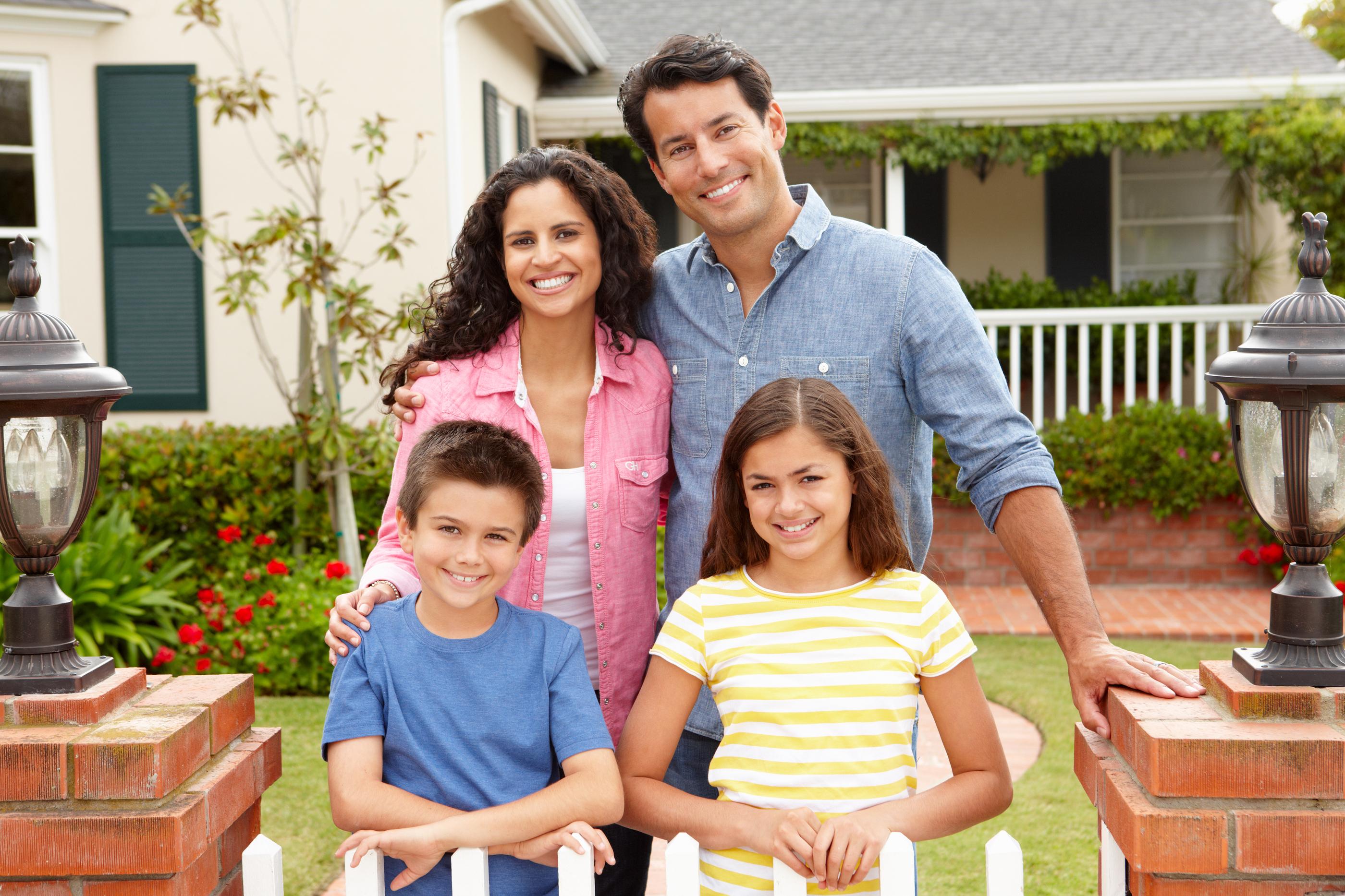 Hispanic family outside home