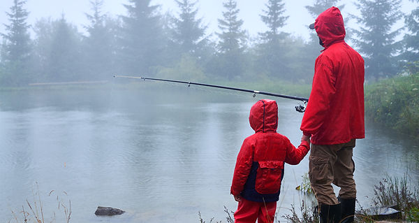 Dad and son fishing in the rain.jpg