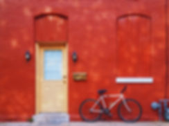 Bicycle Against a Red Wall
