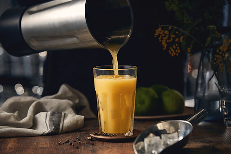 Pouring Beverage from Blending Cup