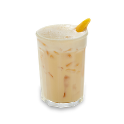 Creamy mango oat milk beverage in a glass