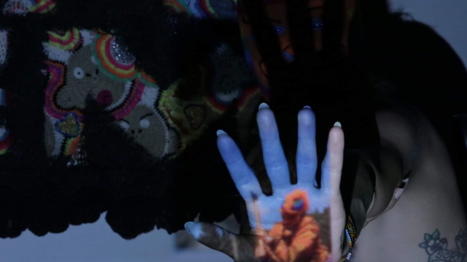 Olek_Projection on hand.jpg