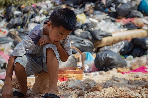 Child waste picker.AdobeStock_265662365.