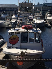 Boat in slip at myrtle beach fishing charter dock