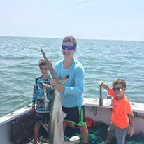 Young Man Holding Big Shark