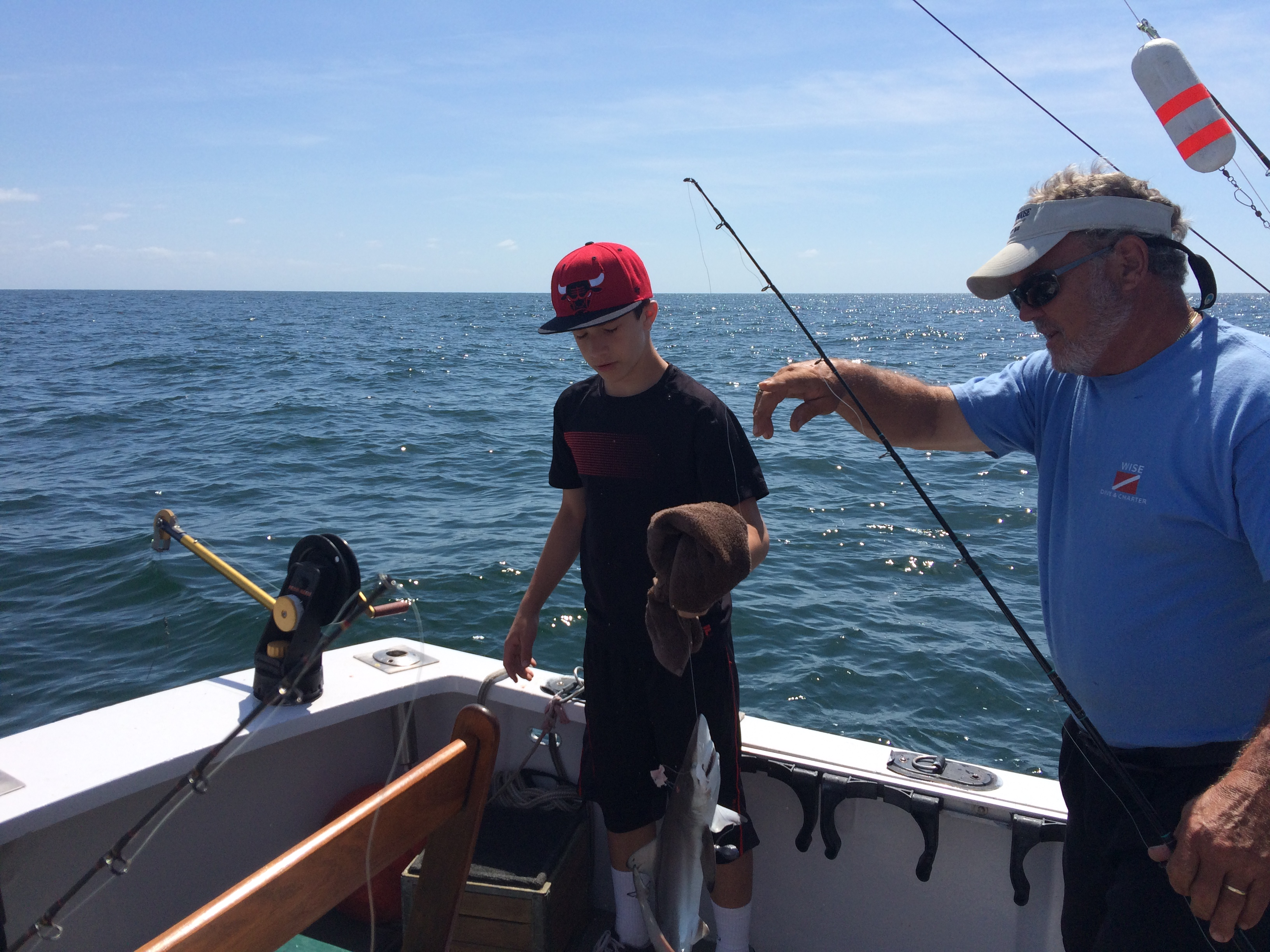 Kid catches sea bass