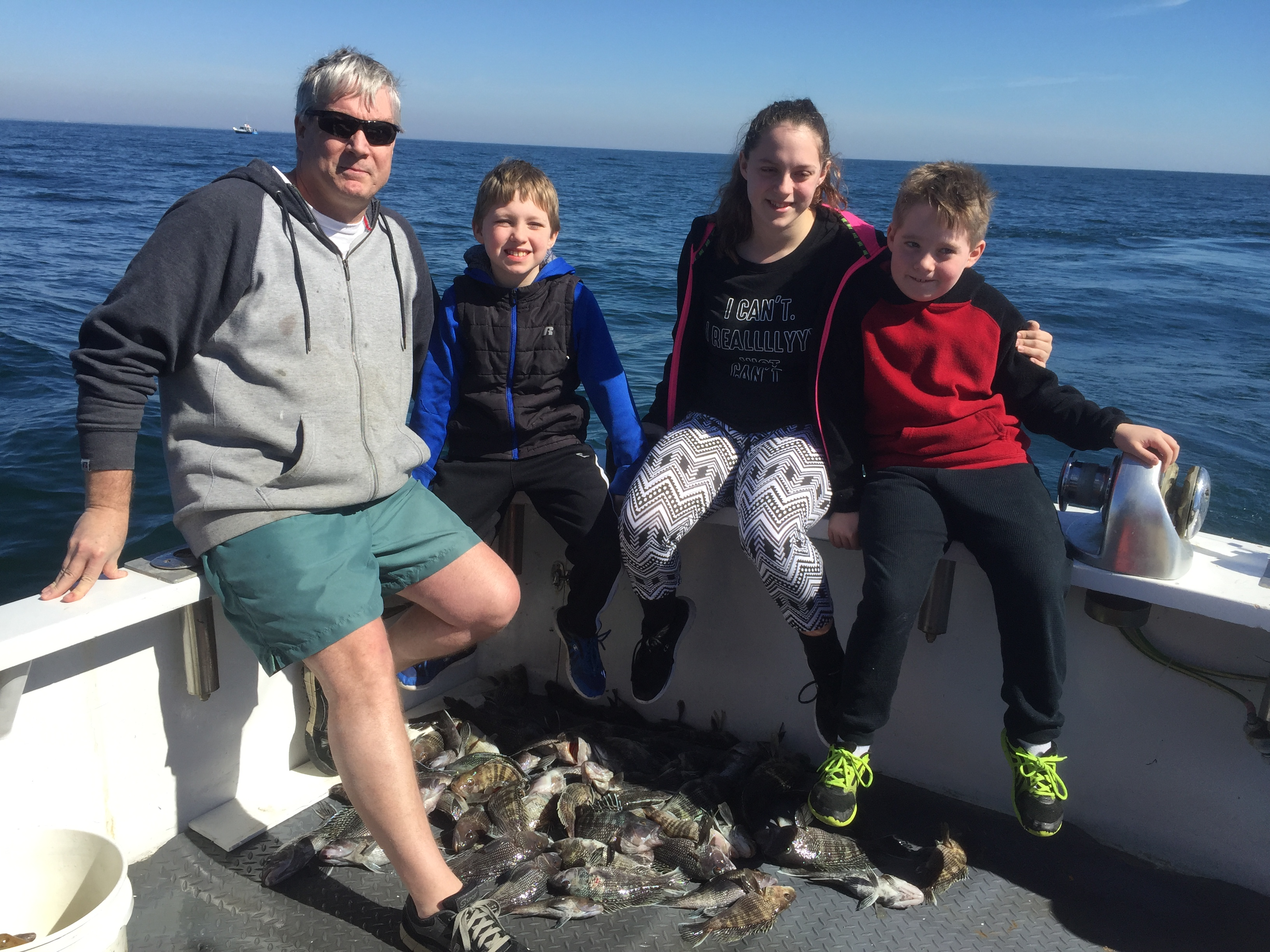 Kids and Father with a bunch of Sea