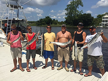 Fishermen Holding Barracuda caught on myrtle beach fishing charter