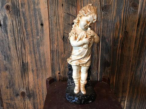 Figurine l'enfant avec la colombe