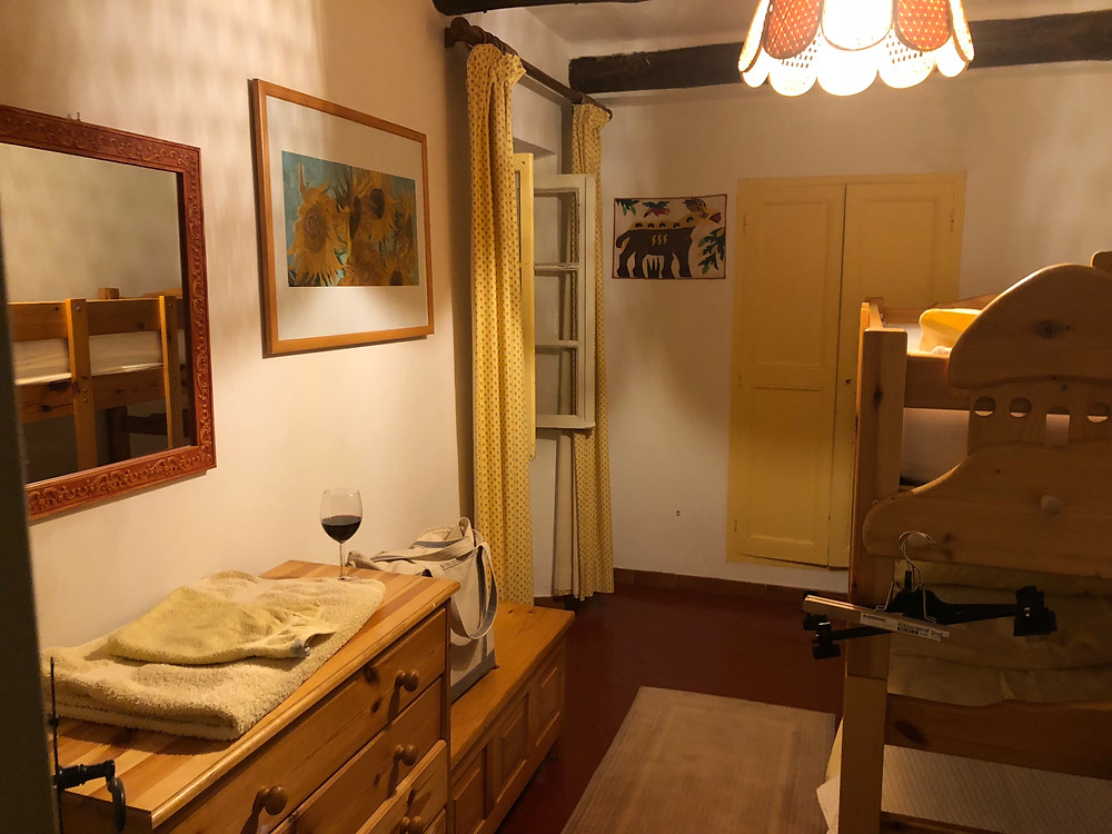 My tiny room (peep the glass of wine).