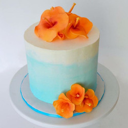 A hibiscus wedding cake with 120 cupcake