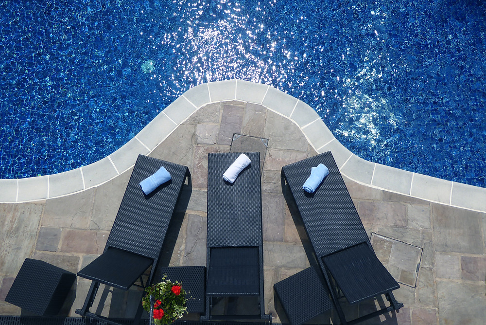 three sunloungers for switching off by the pool