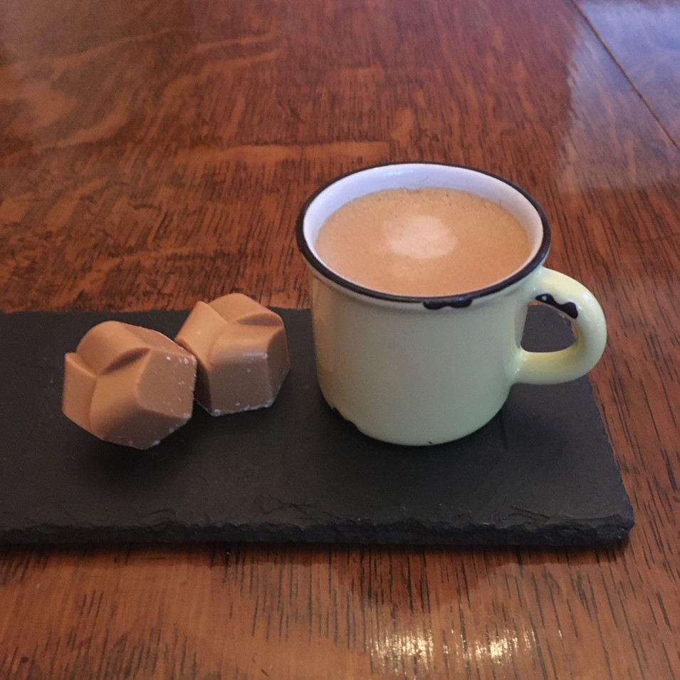 Caramel latte with a cup of espresso