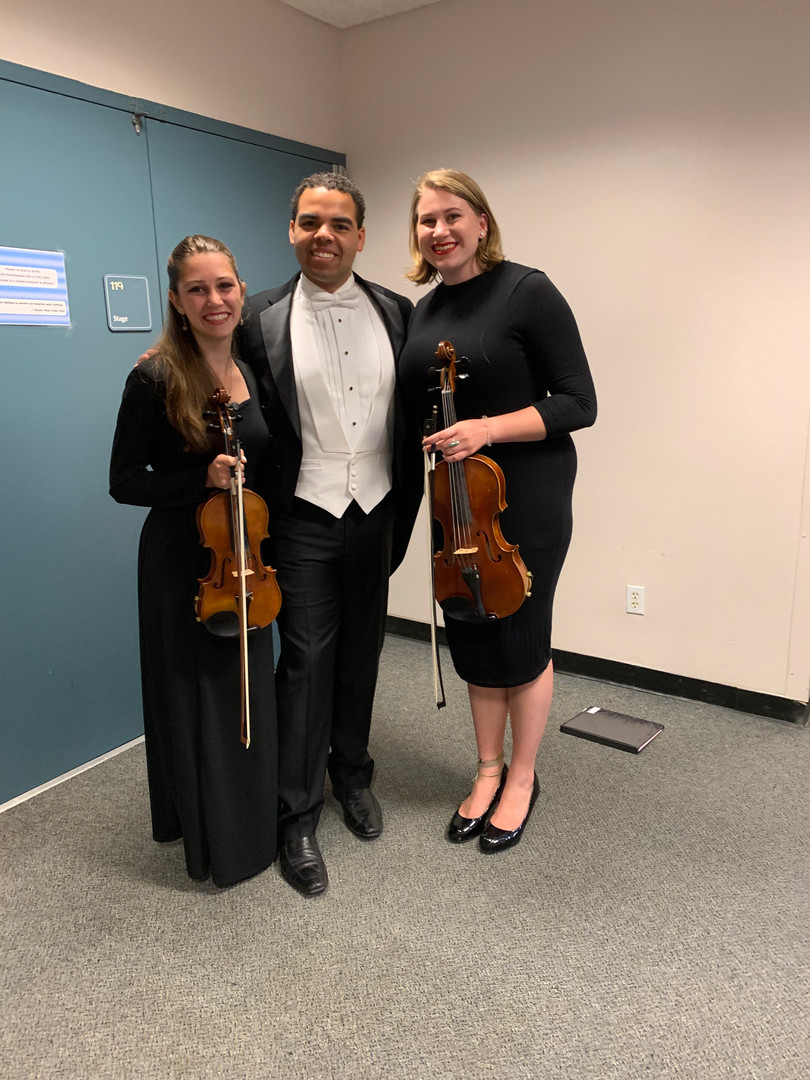 Brandon Di Noto with the principal second violinist and principle violist following a guest conducting appearance with the PLNU Chamber Orchestra.