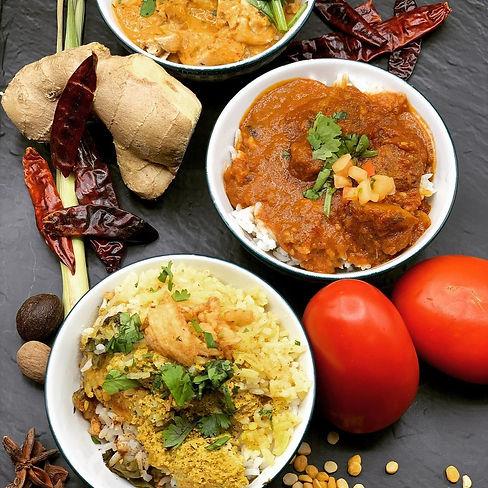 Curry Flight Trio with raw ingredient entourage