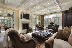 Large family room with fireplace and wall of windows.jpg