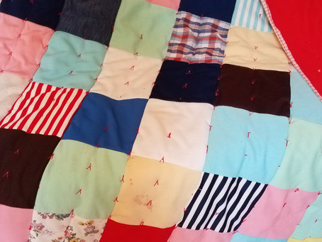 Red back square quilt made by Mary Hansen