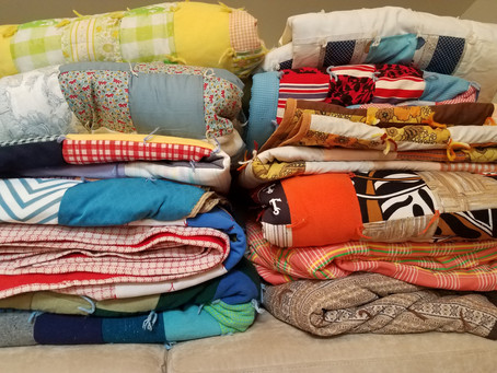 Beautiful Quilt stack with many of the quilts made by Mary Hansen
