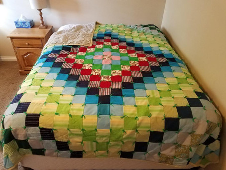 Round the World Double Knit Quilt by Mary (Grandma) Hansen.