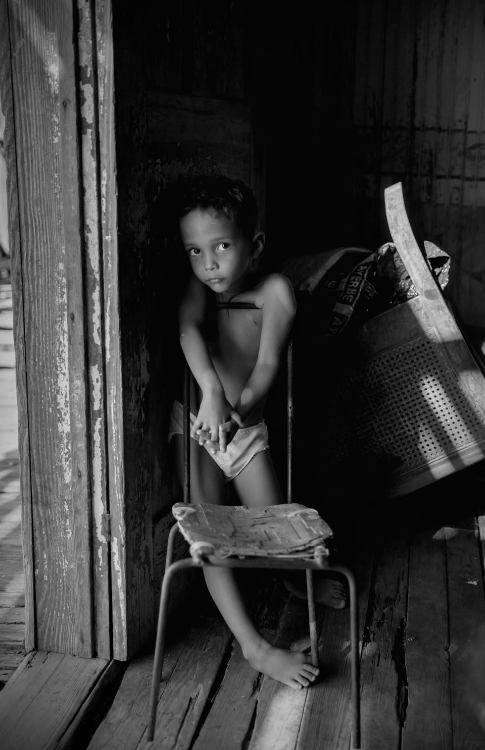Boy in home on River, E. Cuba