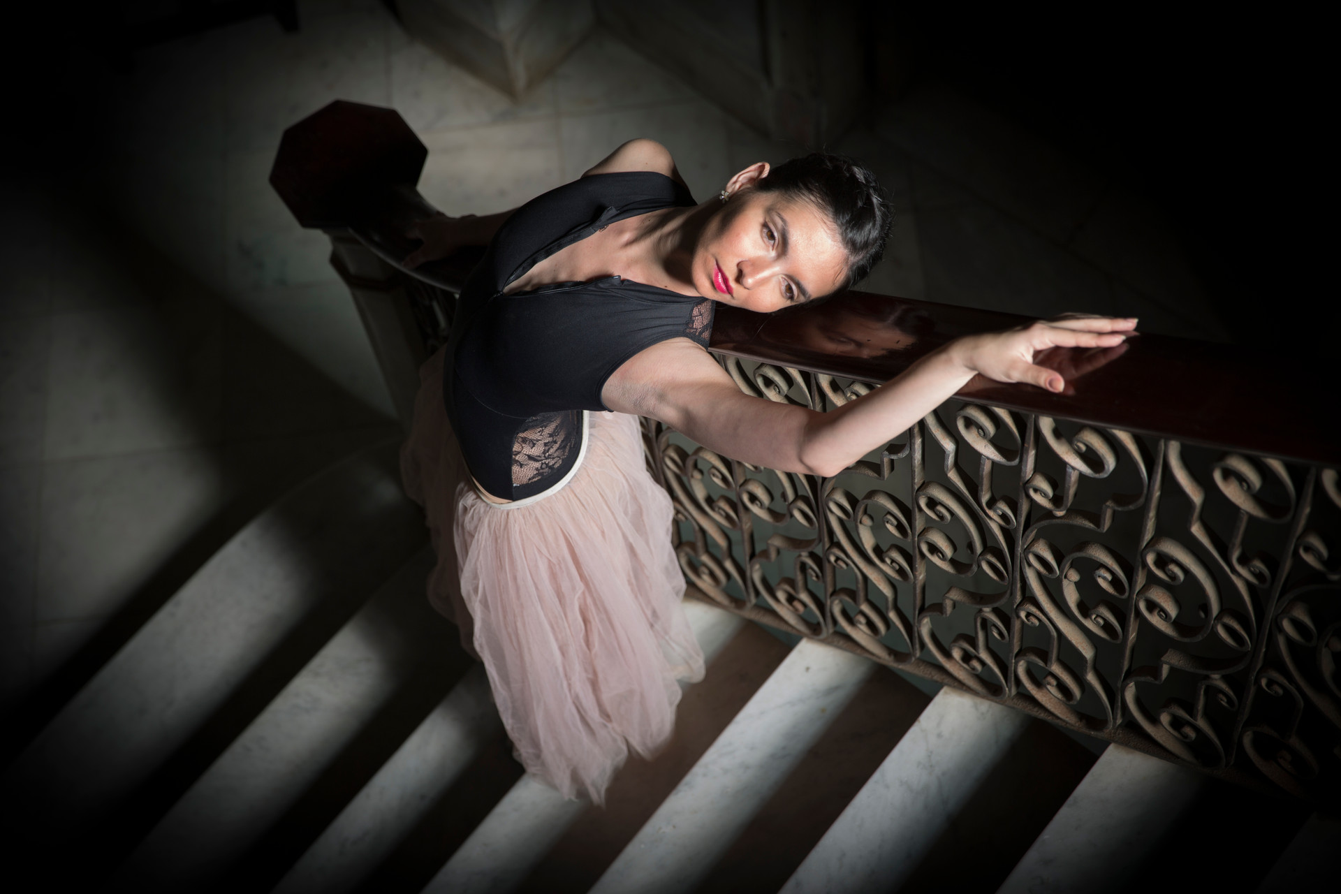 Ballerina on stairs of old mansion in Havana