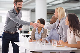 Business meeting with woman and man shaking hands