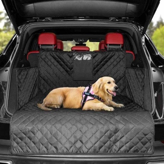 Open hatchback car boot, dog lying on Just Pet Zone boot liner in harness