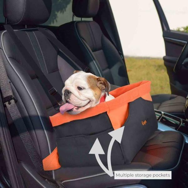 English bulldog sitting in legend car seat in a car