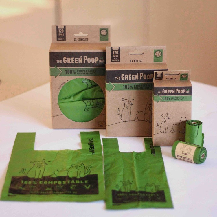 A selection of The Green Poop Bag for dogs with rolls and handled bags