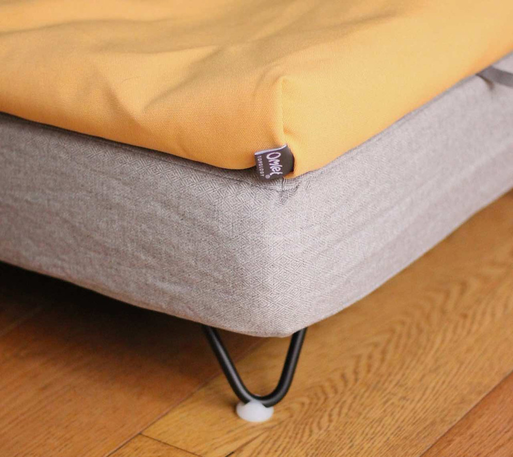 Close up showing the black hairpin legs on the topology dog bed