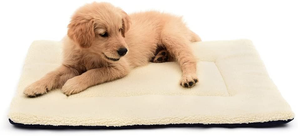 A puppy laying on a Dericor soft dog crate bed