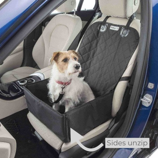 Dog sitting on a Mutt Stuff  front car seat showing seat protection