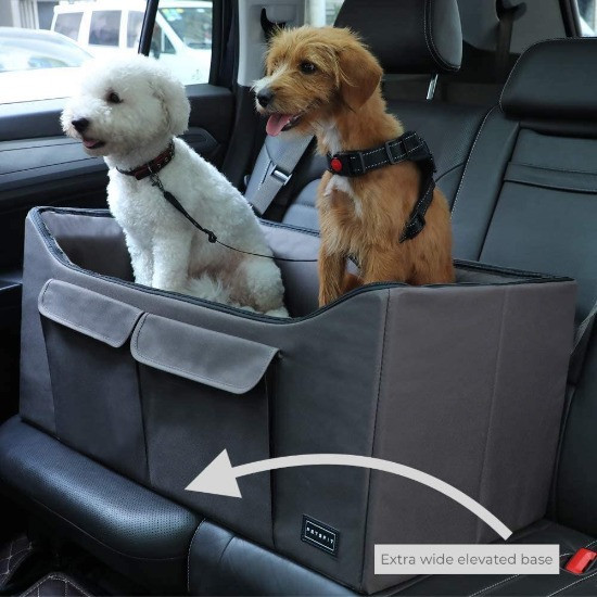 Spaniel sitting in a heritage quilted car seat