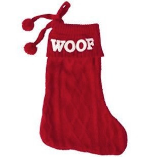 A red christmas stocking for dogs, with WOOF knitted on the top