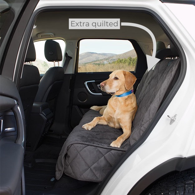 Labrador dog on Orvis grey rear car seat cover showing the quilted cover for comfort