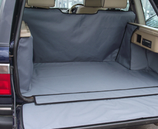 Open car boot with Titan cover custom car boot liner in grey.