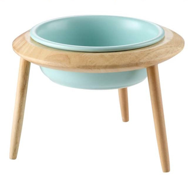 ceramic raised dog bowl in pale blue with bamboo legs
