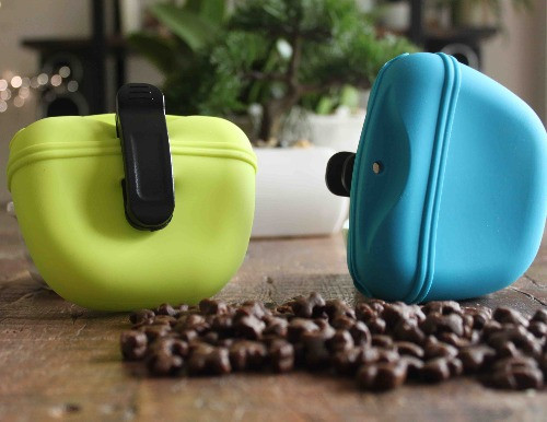 silicone dog treat pouches in green and blue with dog treats