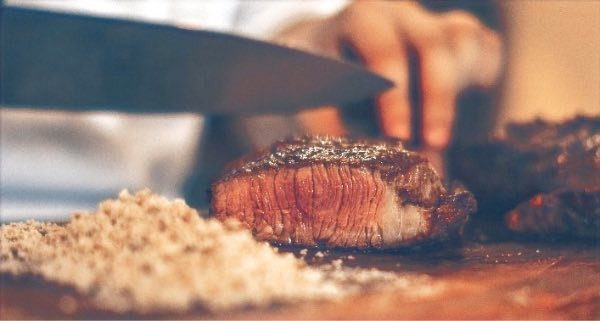 cutting a steak for humans not dog food