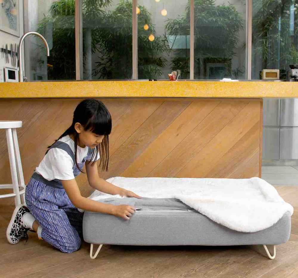 Topology dog bed by Omlet with a sheepskin topper
