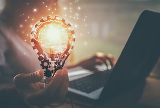 Business women hand holding light bulb,