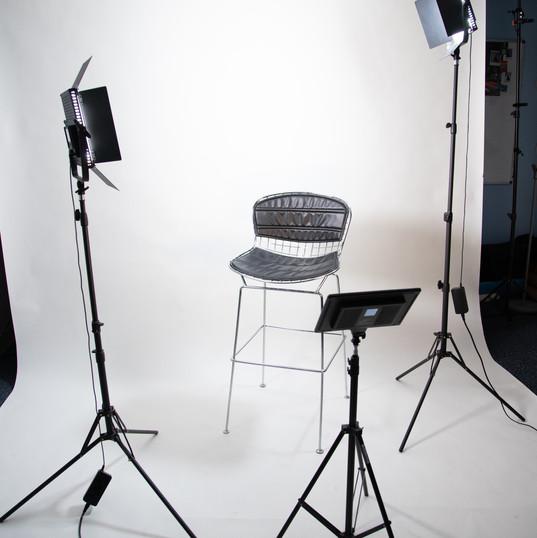 Photo of studio with white backdrop