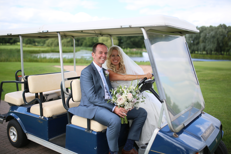 bride and groom shoot golf