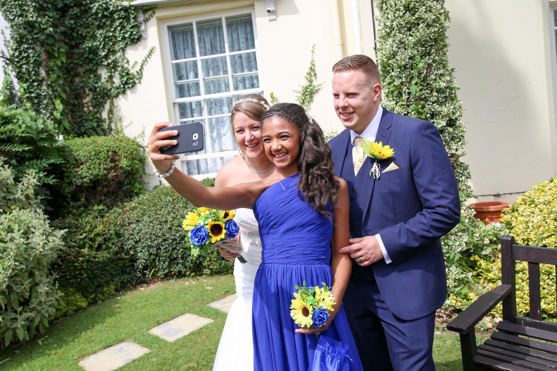 bride groom bridesmaid selfie