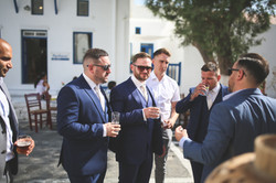 groom banter with groomsmen
