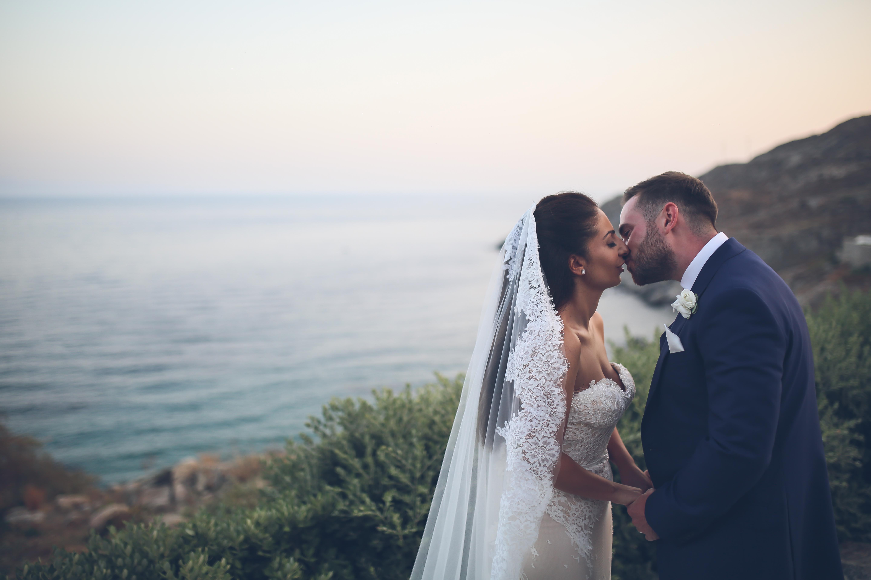 bride and groom kiss in mykonos